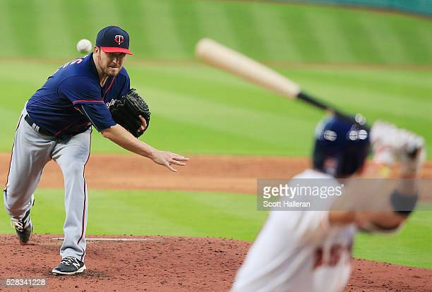 Phil Hughes of the Minnesota Twins throws a pitch in the second inning to Jose Altuve of the Houston Astros during their game at Minute Maid Park on...