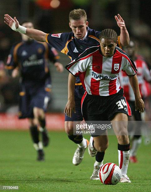 Phil Ifil of Southampton holds off Freddy Eastwood of Wolverhampton Wanderers during the CocaCola Championship match between Southampton and...