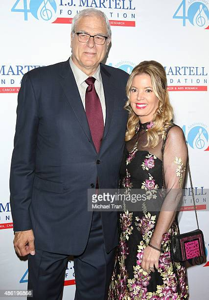 Phil Jackson and Jeanie Buss arrive at the TJ Martell Foundation's Spirit of Excellence Awards held at the Beverly Wilshire Four Seasons Hotel on...
