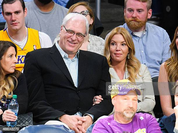 Phil Jackson and Jeanie Buss attend a basketball game between the New York Knicks and the Los Angeles Lakers at Staples Center on March 12 2015 in...