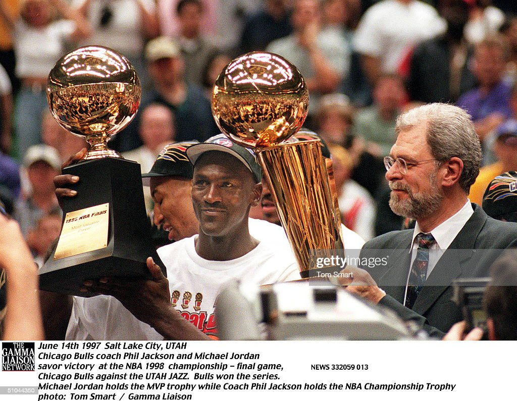 Phil Jackson And Michael Jordan Lift Trophies After Winning Their Sixth Straight Nba Title