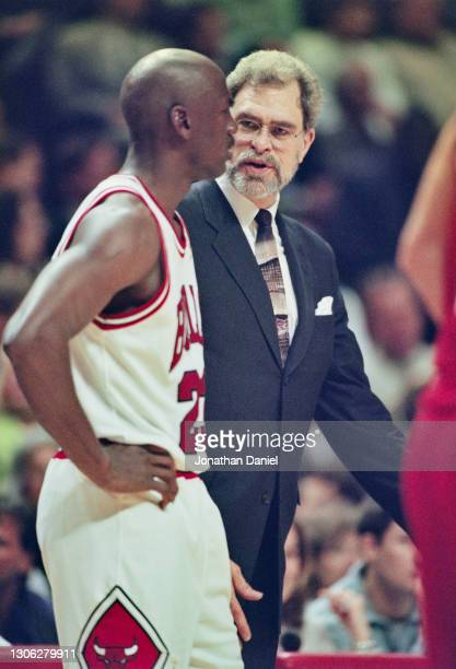 Phil Jackson, Head Coach for the Chicago Bulls talks with Michael Jordan, Shooting Guard for the Bulls during Game 5 of the NBA Eastern Conference...
