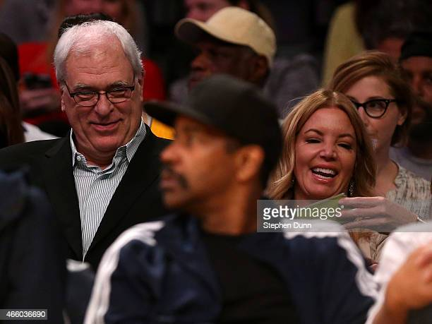 Phil Jackson president of the New York Knicks sits with Jeanie Buss partowner and president the Los Angeles Lakers at Staples Center on March 12 2015...