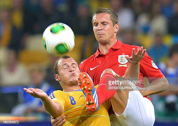 Phil Jagieka of England fights for a ball with Roman Zozulya of Ukraine during their Brazil 2014 FIFA World Cup qualifiers Group H football match in...