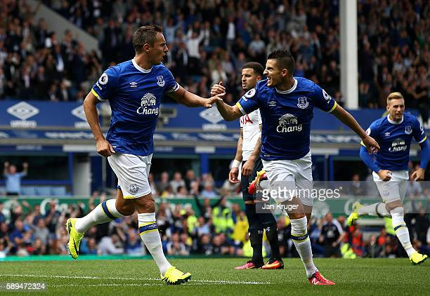 Phil Jagielka and Kevin Mirallas of Everton celebrate the opening goal by team mate Ross Barkley during the Premier League match between Everton and...