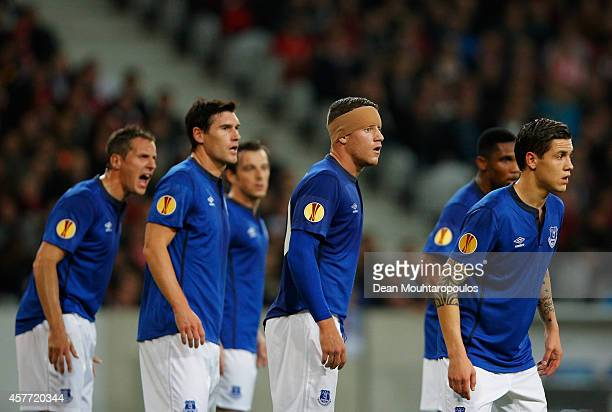Phil Jagielka Gareth Barry Leighton Baines Ross Barkley Samuel Eto'o and Muhamed Besic of Everton defend a free kick during the UEFA Europa League...