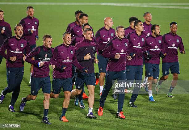 Phil Jagielka Jamie Vardy Ross Barkley and Phil Jones of England lead the warm up during a training session at the LFF Stadium on October 11 2015 in...