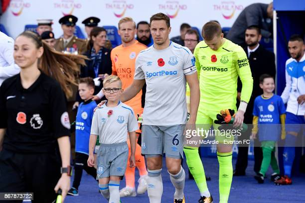 Phil Jagielka leads out his team before the Premier League match between Leicester City and Everton at the King Power Stadium on October 29 2017 in...