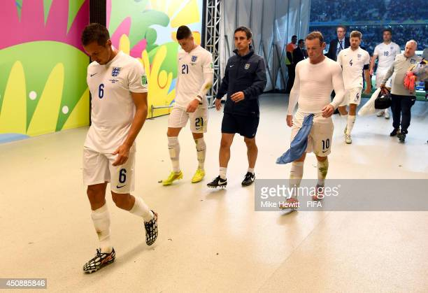 Phil Jagielka of England and England players walk in the tunnel to the dressing room after 2-1 defeat by Uruguay in the 2014 FIFA World Cup Brazil...