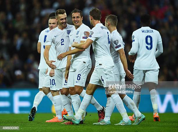 Phil Jagielka of England celebrates with team mates Calum Chambers and Jordan Henderson as he scores their irst goal during the EURO 2016 Group E...