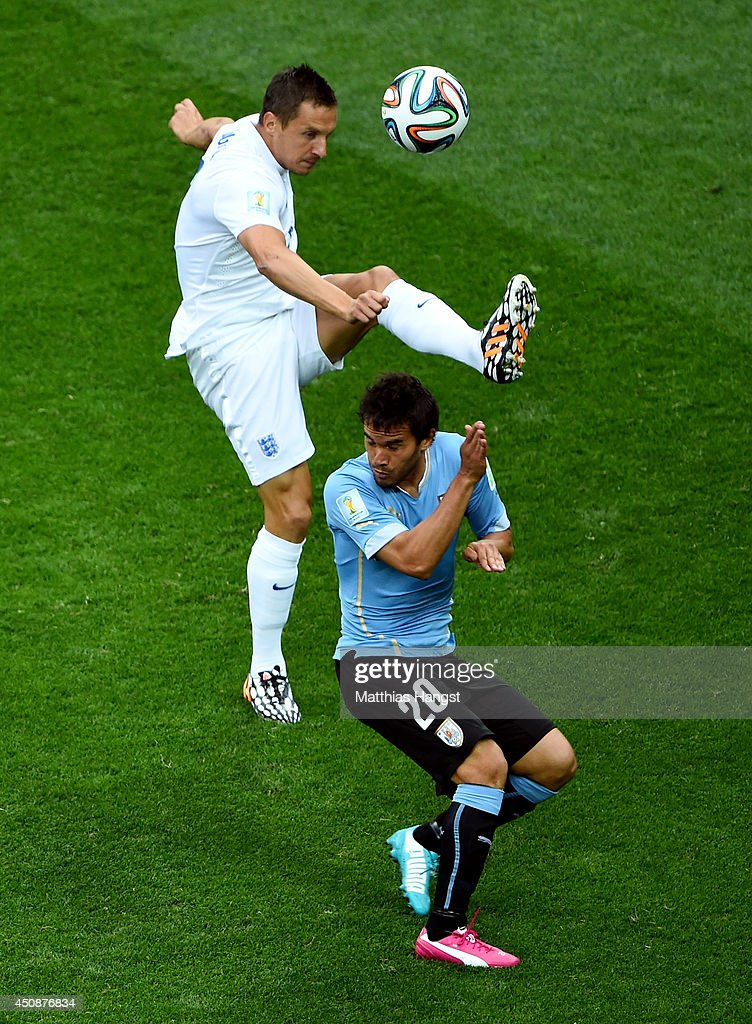 Phil Jagielka of England competes for the ball wtih Alvaro Gonzalez of Uruguay during the 2014 FIFA World Cup Brazil Group D match between Uruguay and England at Arena de Sao Paulo on June 19, 2014 in Sao Paulo, Brazil.