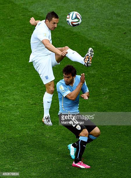 Phil Jagielka of England competes for the ball wtih Alvaro Gonzalez of Uruguay during the 2014 FIFA World Cup Brazil Group D match between Uruguay...