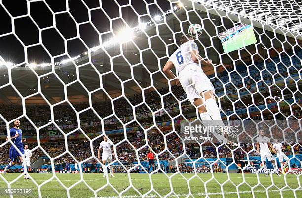 Phil Jagielka of England heads the ball off the line during the 2014 FIFA World Cup Brazil Group D match between England and Italy at Arena Amazonia...