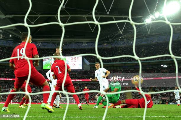 Phil Jagielka of England scores their third goal past Raul Fernandez of Peru during the international friendly match between England and Peru at...