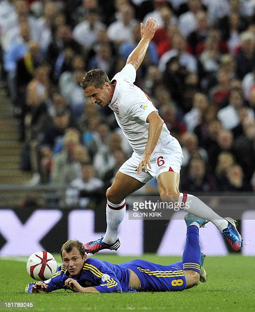 Phil Jagielka of England vies with Roman Zozulya of Ukraine during the 2014 World Cup qualifying football match between England and Ukraine at...