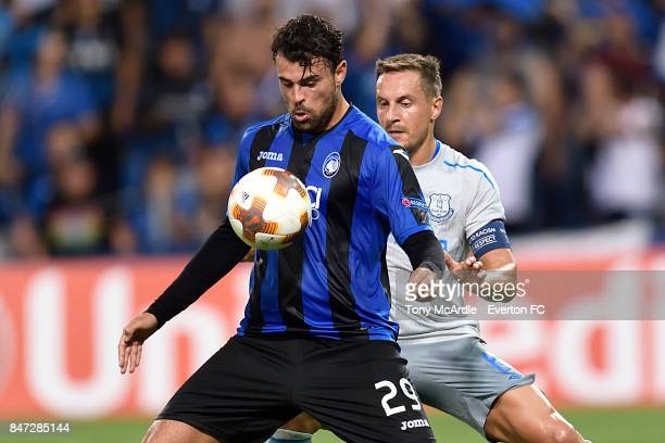 Phil Jagielka of Everton and Andrea Petagna challenge for the ball during the UEFA Europa League Group E match between Atalanta and Everton at Mapei...