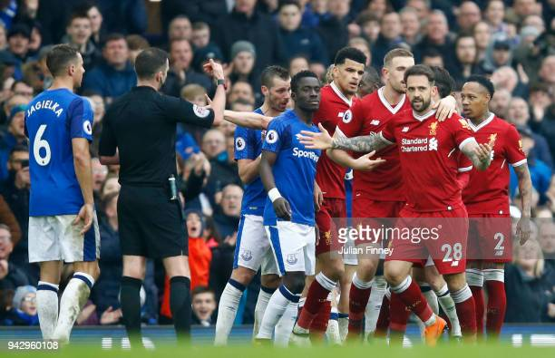 Phil Jagielka of Everton and Danny Ings of Liverpool clash during the Premier League match between Everton and Liverpool at Goodison Park on April 7...