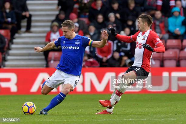 Phil Jagielka of Everton and Dusan Tadic challenge for the ball during the Premier League match between Southampton and Everton at St Mary's Stadium...