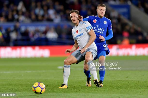 Phil Jagielka of Everton and Jamie Vardy challenge for the ball during the Premier League match between Leicester City and Everton at the King Power...