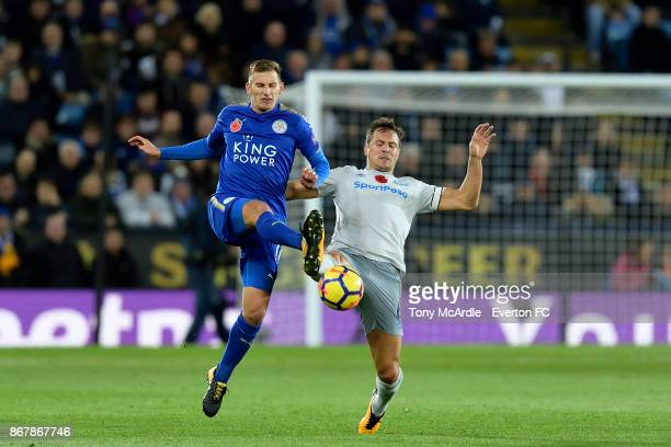 Phil Jagielka of Everton and Marc Albrighton challenge for the ball during the Premier League match between Leicester City and Everton at the King...