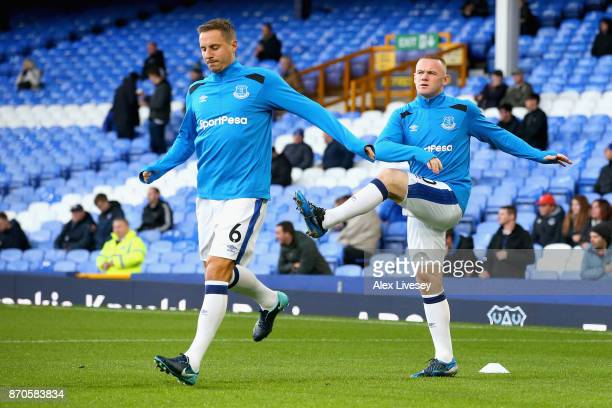 Phil Jagielka of Everton and Wayne Rooney of Everton warms up prior to the Premier League match between Everton and Watford at Goodison Park on...