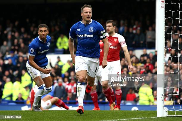 Phil Jagielka of Everton celebrates after scoring his team's first goal during the Premier League match between Everton FC and Arsenal FC at Goodison...