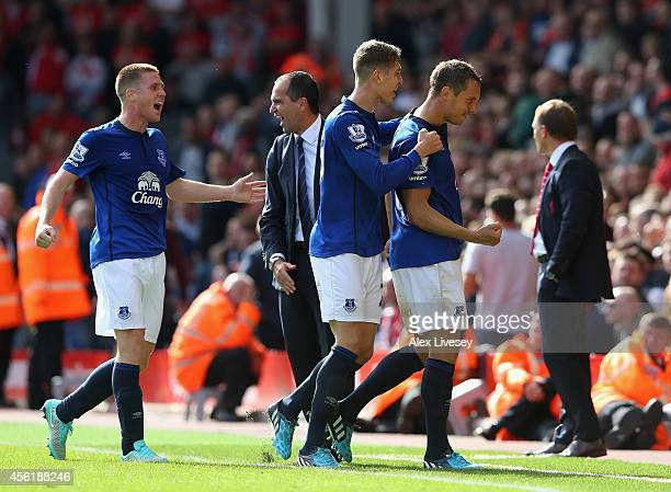 Phil Jagielka of Everton celebrates after scoring the equalising goal during the Barclays Premier League match between Liverpool and Everton at...