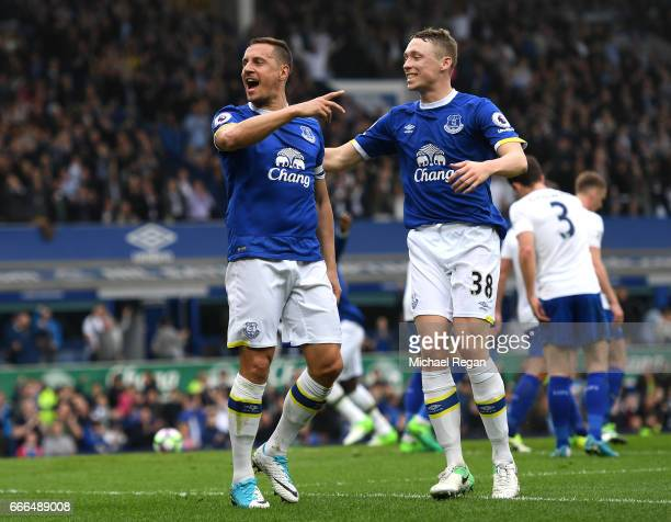 Phil Jagielka of Everton celebrates scoring his team's third goal with Matthew Pennington during the Premier League match between Everton and...