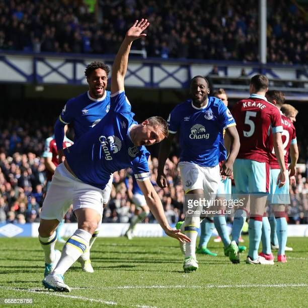 Phil Jagielka of Everton celebrates scoring the first goal to make the score 1-0 during the Premier League match between Everton and Burnley at...