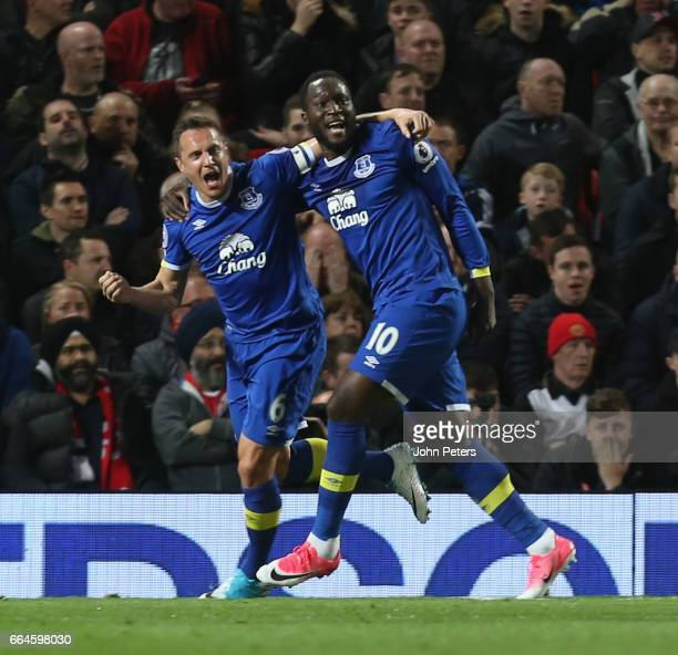 Phil Jagielka of Everton celebrates scoring their first goal during the Premier League match between Manchester United and Everton at Old Trafford on...