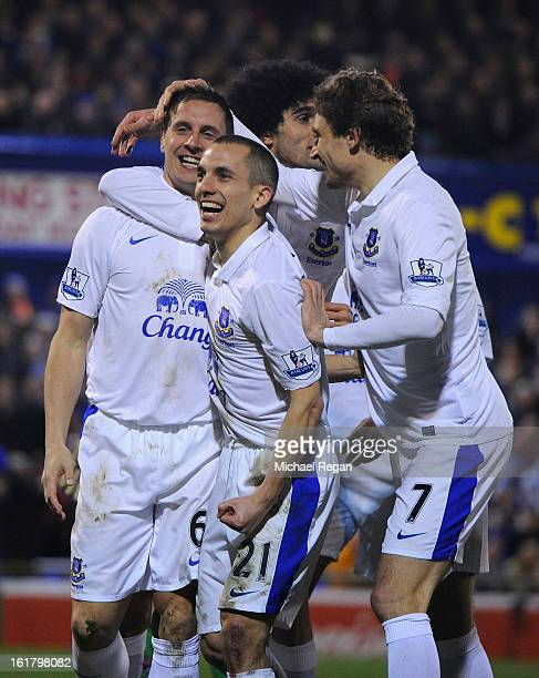 Phil Jagielka of Everton celebrates with his teammates after scoring his team's second goal to make the score 12 during the FA Cup with Budweiser...