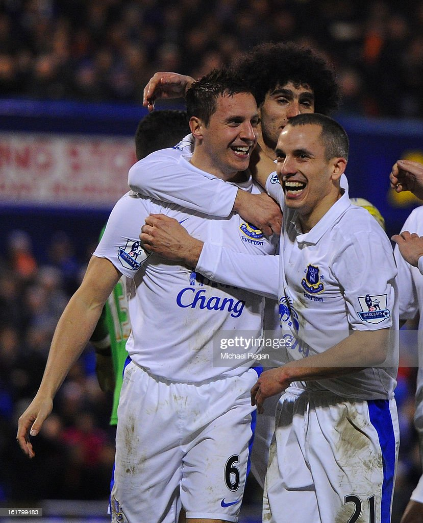 Phil Jagielka of Everton celebrates with his team-mates after scoring his team's second goal to make the score 1-2 during the FA Cup with Budweiser Fifth Round match between Oldham Athletic and Everton at Boundary Park on February 16, 2013 in Oldham, England.