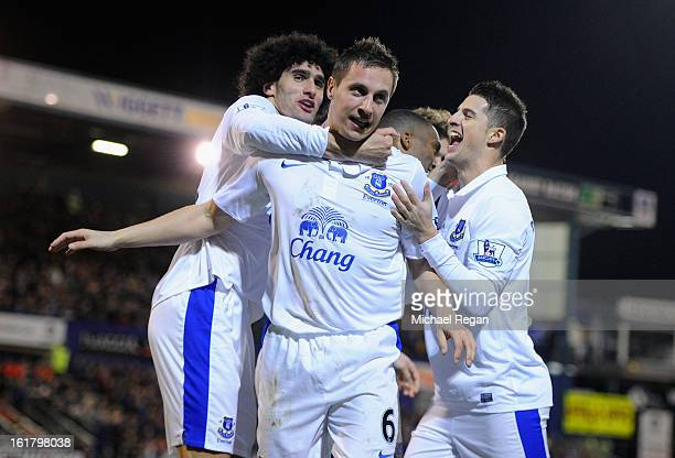 Phil Jagielka of Everton celebrates with his teammates after soring his team's second goal to make the score 12 during the FA Cup with Budweiser...