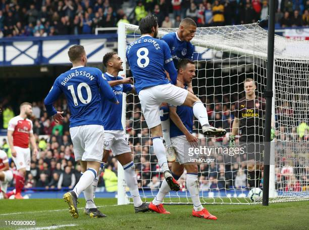 Phil Jagielka of Everton celebrates with team mates after scoring his team's first goal during the Premier League match between Everton FC and...