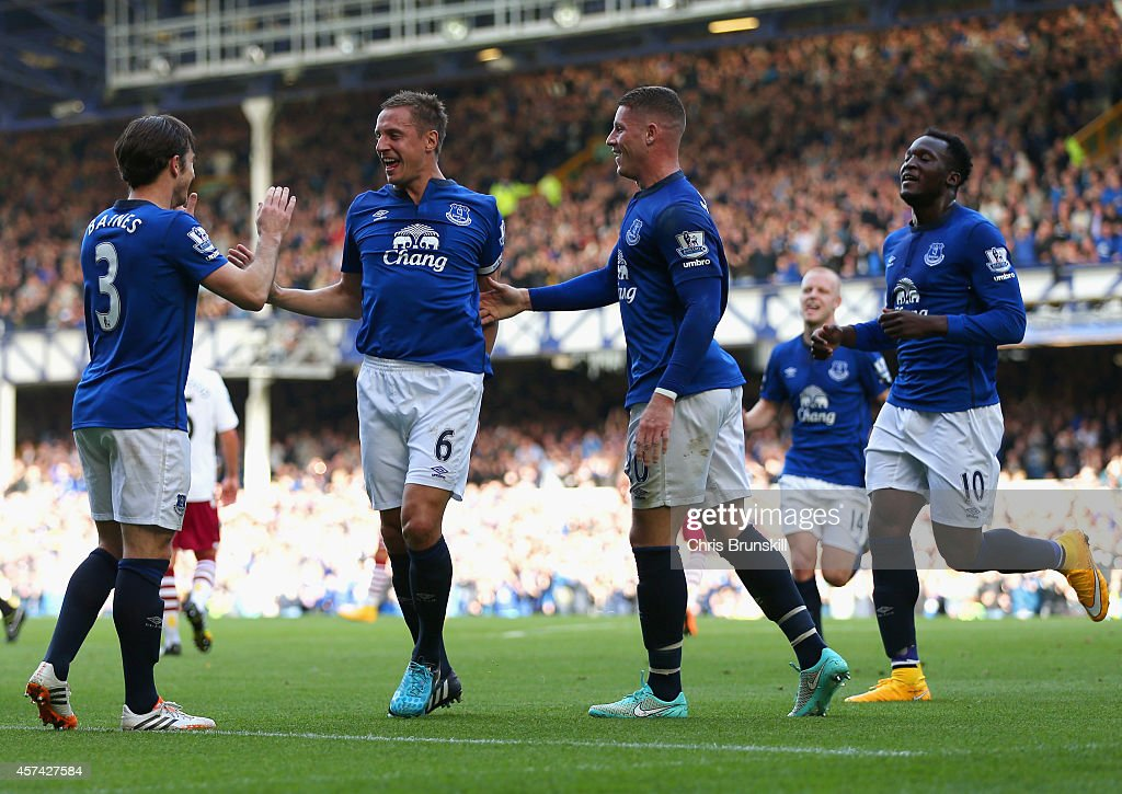 Phil Jagielka of Everton celebrates with team mates after scoring the opening goal during the Barclays Premier League match between Everton and Aston Villa at Goodison Park on October 18, 2014 in Liverpool, England.