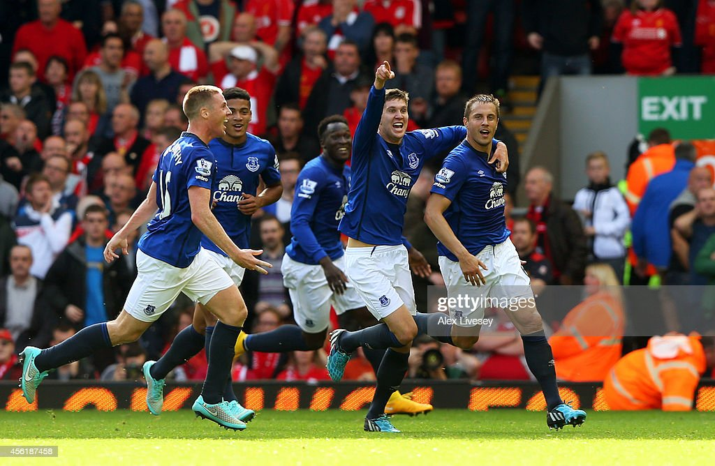 Phil Jagielka (R) of Everton celebrates with teammates after scoring a late goal to level the scores at 1-1 during the Barclays Premier League match between Liverpool and Everton at Anfield on September 27, 2014 in Liverpool, England.