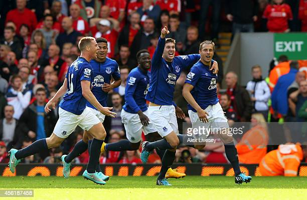 Phil Jagielka of Everton celebrates with teammates after scoring a late goal to level the scores at 11 during the Barclays Premier League match...