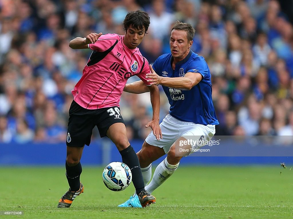 Phil Jagielka of Everton (R) challenges Oliver Torres of Porto during the Pre-Season Friendly between Everton and Porto at Goodison Park on August 3, 2014 in Liverpool, England.