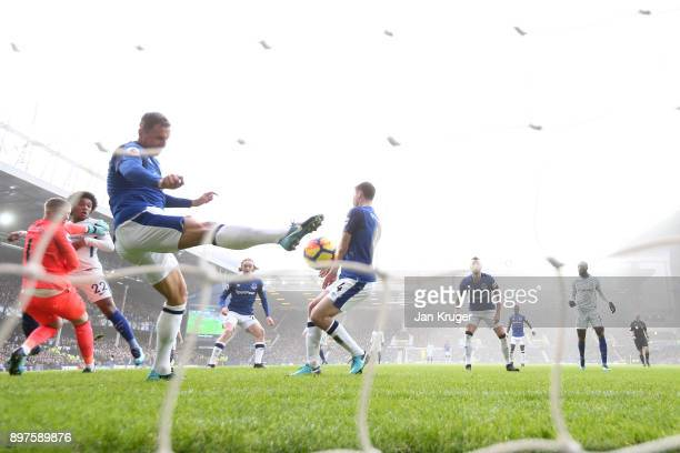 Phil Jagielka of Everton clears the ball off the line during the Premier League match between Everton and Chelsea at Goodison Park on December 23...