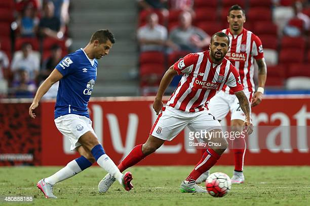 Phil Jagielka of Everton is challenged by Dionatan Teixeira of Stoke City during the Barclays Asia Trophy match between Everton and Stoke City at...