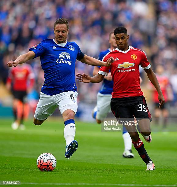 Phil Jagielka of Everton is chased down by Marcus Rashford of Manchester United during The Emirates FA Cup semi final match between Everton and...