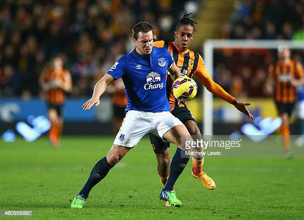 Phil Jagielka of Everton is closed down by Abel Hernandez of Hull City during the Barclays Premier League match between Hull City and Everton at KC...