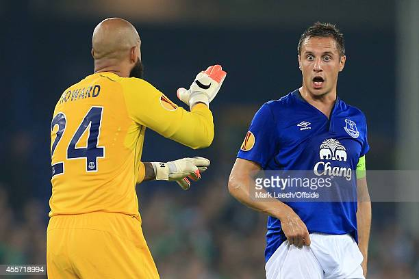 Phil Jagielka of Everton looks shocked as he speaks to Everton goalkeeper Tim Howard during the UEFA Europa League Group H match between Everton and...