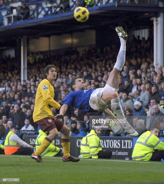 Phil Jagielka of Everton makes an athletic clearance away from Tomas Rosicky of Arsenal during a Barclays Premier League match at Goodison Park on...