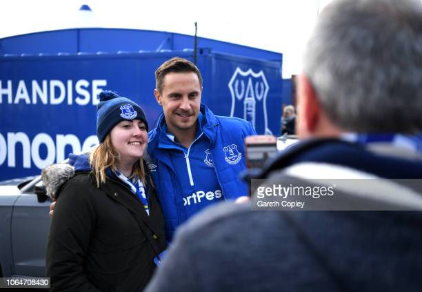 Phil Jagielka of Everton poses for photographs with fans prior to the Premier League match between Everton FC and Cardiff City at Goodison Park on...