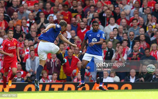 Phil Jagielka of Everton scores a late goal to level the scores at 1-1 during the Barclays Premier League match between Liverpool and Everton at...