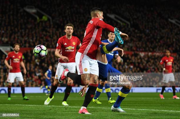 Phil Jagielka of Everton scores his sides first goal during the Premier League match between Manchester United and Everton at Old Trafford on April 4...