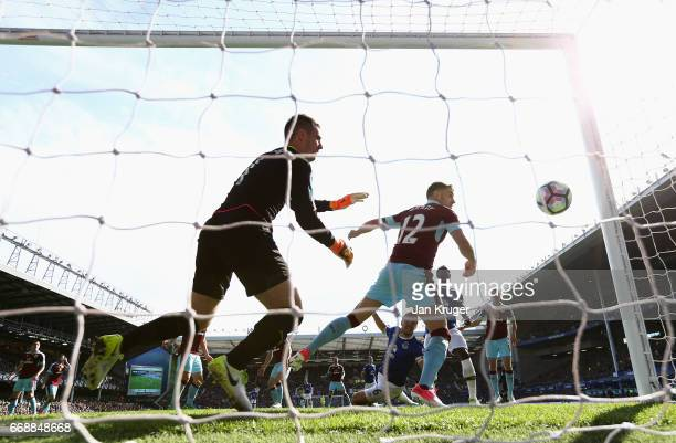 Phil Jagielka of Everton scores his sides first goal during the Premier League match between Everton and Burnley at Goodison Park on April 15 2017 in...