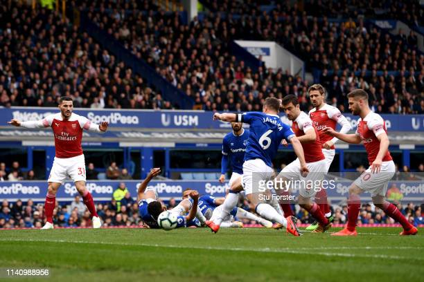 Phil Jagielka of Everton scores his team's first goal during the Premier League match between Everton FC and Arsenal FC at Goodison Park on April 07,...