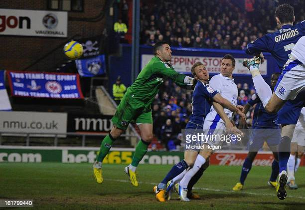 Phil Jagielka of Everton scores his team's second goal to make the score 12 during the FA Cup with Budweiser Fifth Round match between Oldham...